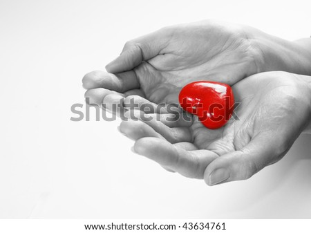 Heart in hands conceptual image. Love, care, health themes.