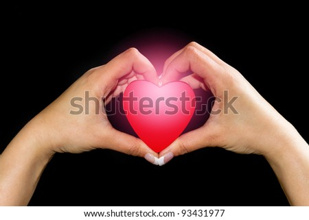 Heart in hands isolated on black #93431977