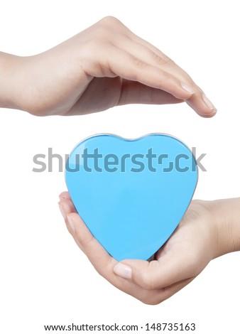 Heart in palms