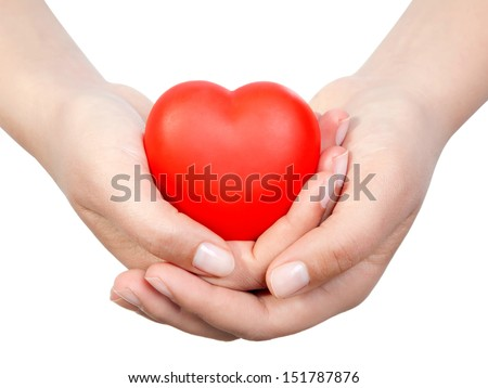 Heart in palms.Isolated on white