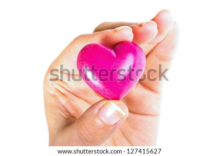 Heart in the hand as love and health symbol