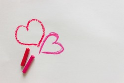 Heart is drawn in red crayons on paper. I Love You. The heart is used as a symbol of love in the message for Valentine's Day.