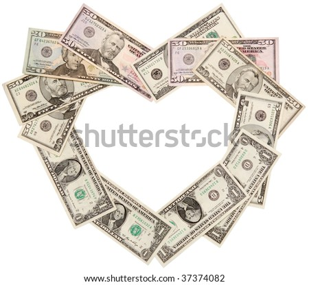 Heart is laid out from dollars of various face value, isolated on a white