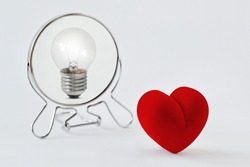 Heart looking in the mirror and seeing itself as a light bulb - Concept of dualism heart and mind, emotion and reason