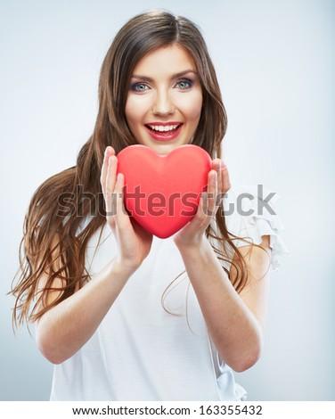 Heart. Love symbol. Portrait of beautiful happy woman hold Valentine day symbol. Isolated studio background female model. Beautiful girl.