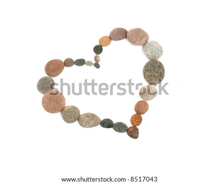 Heart made from pebbles, isolated on white