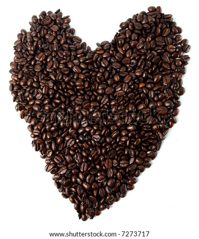 heart made of coffee beans closeup over a white background