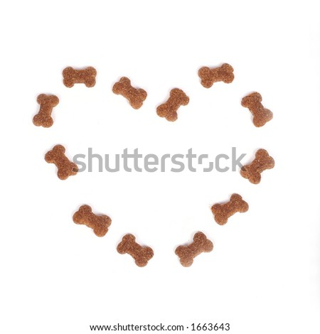 heart made of dog food isolated on white - stock photo