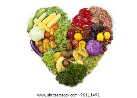 Heart made of fresh fruits and vegetables. Shot in studio isolated on white background