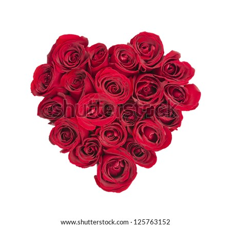 Heart made of fresh red roses on white background