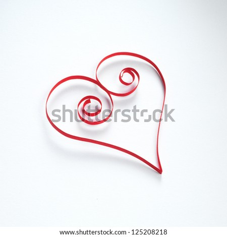 Heart made of paper stripes on white paper background