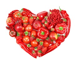 Heart made of red fruits and vegetables on white background