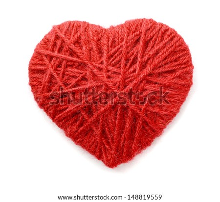 Heart made of red wool yarn isolated on white