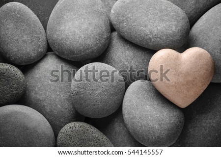 Heart made of stone on natural stones