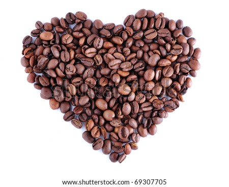 Heart made out of coffee beans on white background