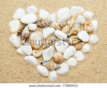 heart made with shells. Heart shape on sand