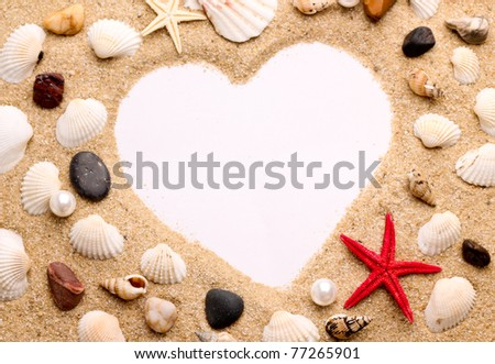heart made with shells . Photo frame of mats and sea shells