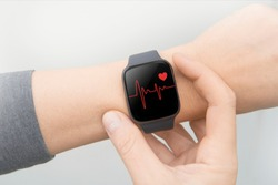 Heart monitor beats with wristwatch.