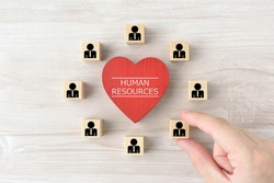 Heart object with human resources word and wooden blocks with businessman pictogram