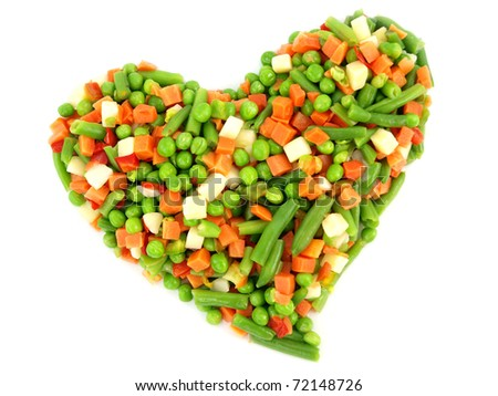 Heart of a frozen mixed vegetables isolated on white background