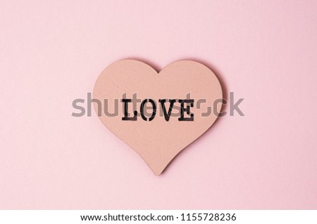 Heart of a pastel color with the inscription love. Close up #1155728236