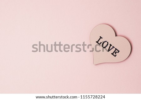 Heart of a pastel color with the inscription love. Holiday background #1155728224