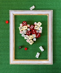 Heart of dices in frame on green cloth, love of gambling