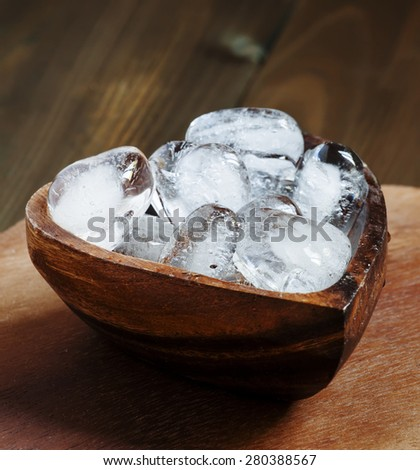 Heart of ice in a wooden bowl, selective focus #280388567