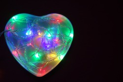 heart of multicolored lights on a dark background