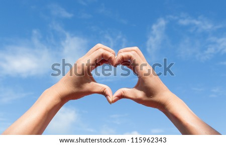 heart of the fingers against the blue sky