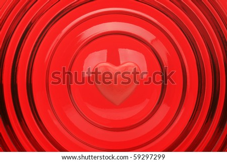 Heart on a red background with concentric circles