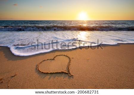 heart on beach. romantic...
