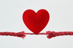 Heart on nearly broken rope - Concept of love and risk