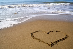 heart on sand on a Sunny summer day. Copy space.
