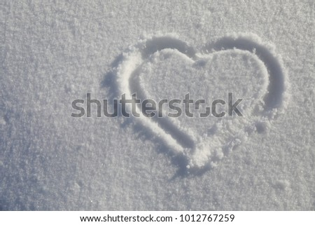 Heart on snow #1012767259