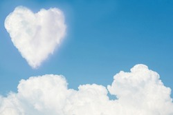 Heart on the sky with cloudy. Blue sky with hearts shape clouds natural background. love concept.