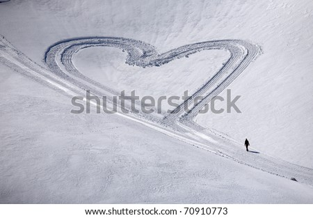 Heart on the snow, with a girl