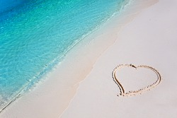 Heart on White Beach Sand in Tropical Paradise