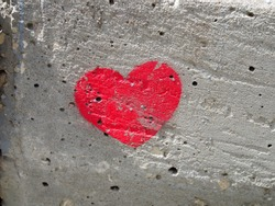 heart painted on a concrete wall, a symbol of love