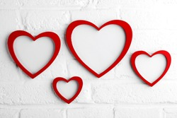 heart picture frame on white wall,valentine concept.