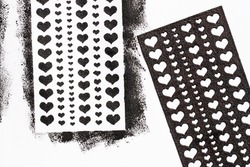 Heart print made with stencil. Decoration to celebrate Valentine's Day. Romantic theme craft.
