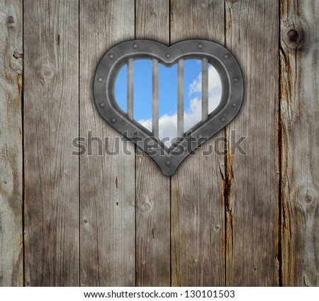 heart prison window on wooden planks background