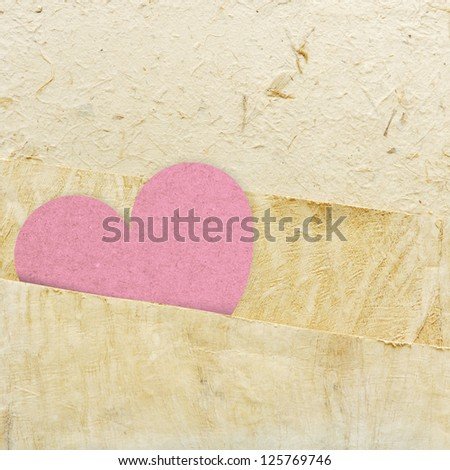 heart recycled paper stick on paper background