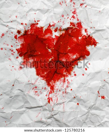 Heart. Red spot in the shape of a heart on crumpled paper