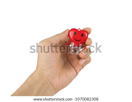 Heart red toy on hand isolated on white background with clipping path.Concept screening and care for the heart or valentine. #1070082308