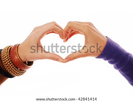 Heart shape being made by female hands on white background