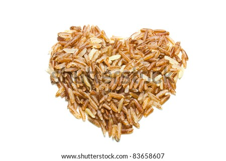 heart shape brown rice isolated on white background
