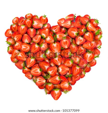 Heart shape by sliced strawberries. Valentine heart.