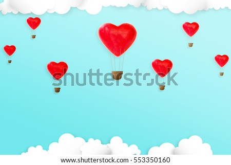 Heart shape candy decorated like hot air balloon on the sky. Concept of love and valentine day  #553350160