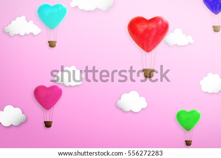 Heart shape candy decorated like hot air balloon on the sky. Concept of love and valentine day #556272283